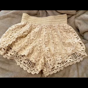 Cream colored lace shorts